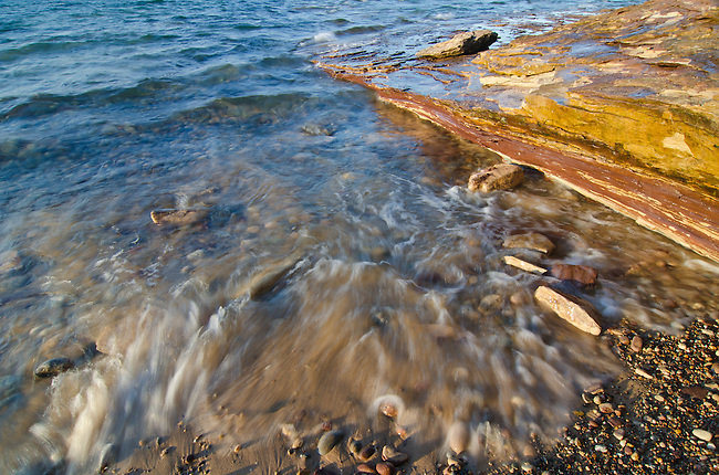 A small section of shoreline on Lake Superior at Twelve Mile Beach in Pictured Rocks National Lakeshore in Alger County, Michigan becomes an abstract artwork when limited to the essence of the scene.