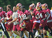 Washington Redskins linebackers participate during the 2013 minicamp at Redskins Park in Ashburn, Virginia on Wednesday, June 12, 2013. Visible from left: Ricky Elmore (51), Kedric Golston (64), Brian Orakpo (98), Stephen Bowen (72), and Darryl Tapp (54), <br /> Credit: Ron Sachs / CNP