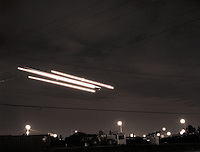 Airplane trailing lights on approach landing, at night