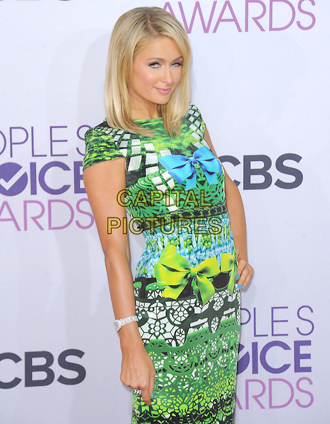 Paris Hilton.The 2013 People's Choice Awards held at Nokia Live in Los Angeles, California 9th January 2013                                                                   .half length dress hand on hip blue black green yellow turquoise pattern print dress platform bow ribbon.CAP/DVS.©DVS/Capital Pictures.