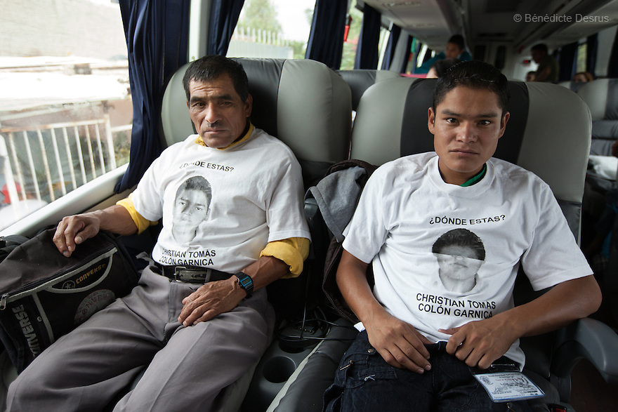 Juan Colon (L) and Jose Luis Colon (R), father and brother of Christian Tomas Colon Garnica, one of the 43 missing students from Ayotzinapa's teacher training college, sit in one of the Caravan for Ayotzinapa's bus. Parents and relatives of the 43 missing students from Ayotzinapa's teacher training college, still do not believe the official line that the young men are all dead, and with classmates, social organizations and human rights defenders, they started on Thursday a national caravan. They split up into three different caravans, branching out to share information face to face with supporters in other cities and rally nationwide support. The three groups will meet in Mexico City on Thursday 20 for a general strike and massive marches to demand justice and fight against corrupted government and organized crime. Criticism of the government has intensified in Mexico, and many are demanding that the search for the 43 missing students continue until there is concrete evidence to the contrary. (Photo by BénédicteDesrus)