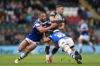 George Ford of Leicester Tigers is double-tackled by Max Lahiff and Francois Louw of Bath Rugby. Gallagher Premiership match, between Leicester Tigers and Bath Rugby on May 18, 2019 at Welford Road in Leicester, England. Photo by: Patrick Khachfe / Onside Images