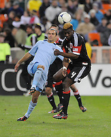 D.C. United defender Brandon McDonald (4) heads the ball against Sporting Kansas City midfielder Graham Zusi (8) Sporting Kansas City defeated D.C. United  1-0 at RFK Stadium, Saturday March 10, 2012.