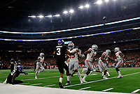 Ohio State Buckeyes defensive tackle Dre'Mont Jones (86) returns an interception  for a touchdown as his teammates lead the way in blocking during the 3rd quarter of their game at AT&T Stadium at Arlington, Texas on September 15, 2018.  TCU Horned Frogs quarterback Shawn Robinson (3) throw the interception.   [Kyle Robertson/Dispatch]