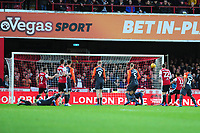 Ollie Watkins of Brentford scores his side's first goal during the Sky Bet Championship match between Brentford and Swansea City at Griffin Park, Brentford, England, UK. Saturday 08 December 2018