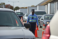 October 27, 2012 (Washington, DC)  D.C. Department of Public Works (DPW) employee Ray Woody directs vehicles picking up sandbags at RFK Stadium lot in preparation for Hurricane Sandy  (Photo by Don Baxter/Media Images International)