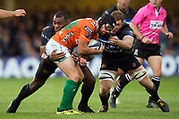 Ian McKinley of Benetton Rugby is double-tackled by Semesa Rokoduguni and Sam Underhill of Bath Rugby. European Rugby Champions Cup match, between Bath Rugby and Benetton Rugby on October 14, 2017 at the Recreation Ground in Bath, England. Photo by: Patrick Khachfe / Onside Images