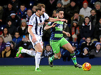Gareth McAuley of West Bromwich Albion and Neil Taylor of Swansea City during the Barclays Premier League match between West Bromwich Albion and Swansea City at The Hawthorns on the 2nd of February 2016