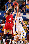 BROOKINGS, SD - JANUARY 17:  Ellie Thompson #45 from South Dakota State looks to block the shot of Tia Hemiller #4 from the University of South Dakota in the first half of their game Sunday afternoon at Frost Arena in Brookings, S.D. (Photo by Dave Eggen/Inertia)