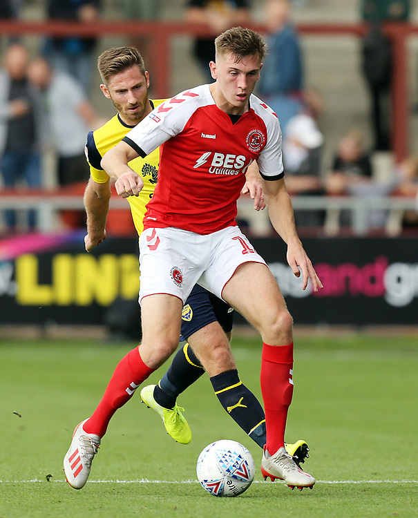 Fleetwood Town's Jimmy Dunne under pressure from Oxford United's Sam Long<br /> <br /> Photographer Rich Linley/CameraSport<br /> <br /> The EFL Sky Bet League One - Fleetwood Town v Oxford United - Saturday 7th September 2019 - Highbury Stadium - Fleetwood<br /> <br /> World Copyright © 2019 CameraSport. All rights reserved. 43 Linden Ave. Countesthorpe. Leicester. England. LE8 5PG - Tel: +44 (0) 116 277 4147 - admin@camerasport.com - www.camerasport.com