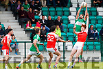 Legion Shaun Keane claims the ball from the sky over Mikey O'Baoill Dingle during their Club Championship clash in Killarney on Sunday
