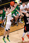 RAPID CITY, S.D.-- MARCH 21, 2015:  Daniel Holmstrom #5 of Aberdeen Roncalli takes a 3-point shot past defender Zane Schumaker #3 of Dell Rapids during their championship game at the 2015 South Dakota  State A Boys Basketball Tournament at the Don Barnett Arena in Rapid City Saturday. (Photo by Dick Carlson/Inertia)