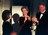 "United  States President Bill Clinton and first lady Hillary Rodham Clinton applaud one of the ""1998 Kennedy Center Honors"" recipients, Shirley Temple Black, during a ceremony in the East Room of the White House in Washington, D.C. on December 6, 1998..Credit: Ron Sachs -  CNP"