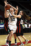 03/10/11--Tigard's Maddie Black shoots over Oregon City's Montana Walters in the quarterfinals of girls 6A championship at the Rose Garden in Portland, Or. The Pioneers advanced to the semifinals with a score of 66-36...Photo by Jaime Valdez........................................