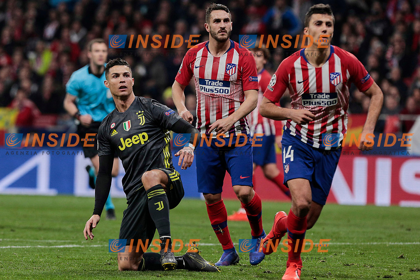 Atletico de Madrid's Koke Resurreccion (L) and Rodrigo Hernandez (R) and Juventus' Cristiano Ronaldo during UEFA Champions League match, Round of 16, 1st leg between Atletico de Madrid and Juventus at Wanda Metropolitano Stadium in Madrid, Spain. February 20, 2019. (Insidefoto/ALTERPHOTOS/A. Perez Meca)<br /> ITALY ONLY
