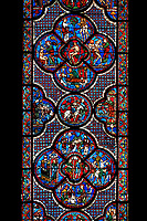 Medieval stained glass Window of the Gothic Cathedral of Chartres, France - dedicated to the Good Samaritan .  Bottom central panel shows A bandit prepares to attack the pilgrim , below left -The pilgrim leaving Jerusalem, right -  The pilgrim is beaten, robbed and stripped , above - A Priest and a Levite see the injured man but walk on past. Central oval panel - The Samaritan leading the Pilgrim to an inn, left of this - A Samaritan binds the injured man's wounds, right of centre - An innkeeper welcoming the Samaritan. Top central panel shows Adam dwelling in Paradise, below - At the inn, the Samaritan nurses the injured man back to health, left - God breathing life into Adam, above - God warning Adam and Eve not to eat from the tree of knowledge, right - God creates Eve out of Adam's rib . A UNESCO World Heritage Site.