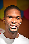 "MIAMI, FL - DECEMBER 20: Chris Bosh attends The 5th Annual ""Christmas with Chris Bosh"" in Santa Bosh's Workshop and 200 Miami-area youth at Game Time at The Shops At Sunset Placel on Saturday, December 20, 2014 in Miami, Florida. (Photo by Johnny Louis/jlnphotography.com)"