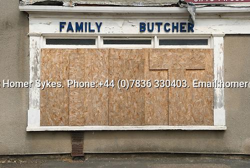 Family Butchers shop boareded up closed down Sutton Bridge, Lincolnshire. UK 2008.