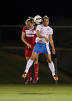 Marisa Abegg (4) of the Washington Spirit goes up for a header with Jey Hoy (2) of the Chicago Red Stars during a game at the Maryland SoccerPlex in Boyds, MD.