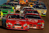 Nov 13, 2005; Phoenix, Ariz, USA;  Nascar Nextel Cup drivers Ricky Rudd and Kasey Kahne lead the field during the Checker Auto Parts 500 at Phoenix International Raceway. Mandatory Credit: Photo By Mark J. Rebilas