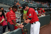 Birmingham Barons third baseman Trey Michalczewski (8) signs autographs before a game against the Pensacola Blue Wahoos on May 2, 2016 at Regions Field in Birmingham, Alabama.  Pensacola defeated Birmingham 6-3.  (Mike Janes/Four Seam Images)