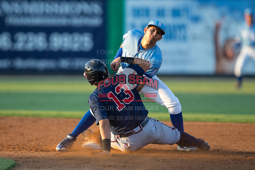 Austin Riley (13) of the Danville Braves is tagged out by Burlington Royals shortstop Jose Martinez (2) as he attempted to steal second base at Burlington Athletic Park on August 13, 2015 in Burlington, North Carolina.  The Braves defeated the Royals 6-3. (Brian Westerholt/Four Seam Images)