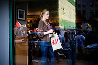 People in a Starbucks coffee shop watch as OccupyBoston marches through the streets of Back Bay, a high-traffic shopping area, in Boston, Massachusetts, USA. The protesters are part of  OccupyBoston, which is part of the OccupyWallStreet movement, expressing discontent with the socioeconomic situation of the 99% of the US population who are not wealthy.  Protestors have been camping in Dewey Square since Sept. 30, 2011. Gradually, larger organizations, including major labor unions, have expressed their support for the OccupyBoston effort.
