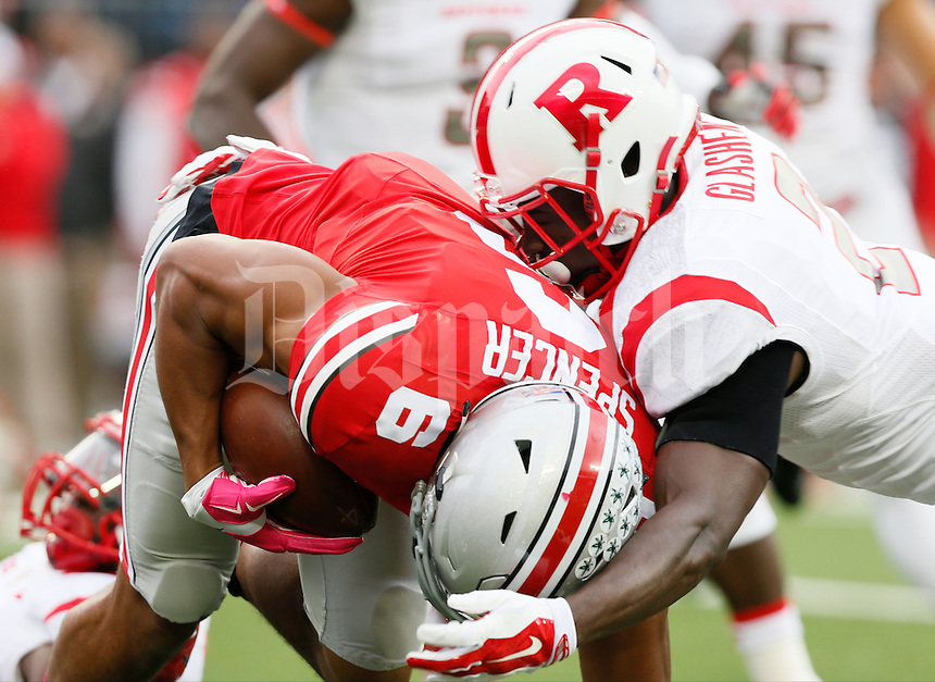 Ohio State Buckeyes wide receiver Evan Spencer (6) is tackled by Rutgers Scarlet Knights defensive back Gareef Glashen (2) during Saturday's NCAA Division I football game between the Ohio State Buckeyes and the Rutgers Scarlet Knights at Ohio Stadium in Columbus. The Buckeyes led at halftime 35-7. (Dispatch Photo by Barbara J. Perenic)