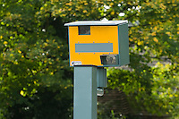 Speed cameras take photos of motorists who exceed the speed limit.  Notification of a speeding fine is sent through the post.