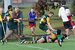 Sione Fifita crashes over in the corner to score one of his three tries. Counties Manukau Premier Club rugby game between Pukekohe and Waiuku, played at Colin Lawrie Fields, Pukekohe on Saturday April 14th, 2018. Pukekohe won the game 35 - 19 after leading 9 - 7 at halftime.<br /> Pukekohe Mitre 10 Mega -Joshua Baverstock, Sione Fifita 3 tries, Cody White 3 conversions, Cody White 3 penalties.<br /> Waiuku Brian James Contracting - Lemeki Tulele, Nathan Millar, Tevta Halafihi tries,  Christian Walker 2 conversions.<br /> Photo by Richard Spranger