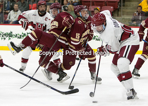Connor Moore (BC - 7), JD Dudek (BC - 15), Ryan Donato (Harvard - 16) - The Harvard University Crimson defeated the visiting Boston College Eagles 5-2 on Friday, November 18, 2016, at Bright-Landry Hockey Center in Boston, Massachusetts.{headline] - The Harvard University Crimson defeated the visiting Boston College Eagles 5-2 on Friday, November 18, 2016, at Bright-Landry Hockey Center in Boston, Massachusetts.