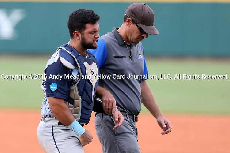 31 May 2016: Nova Southeastern's Michael Hernandez (left) is helped off of the field by a trainer after suffering a game-ending injury. The Nova Southeastern University Sharks played the Lander University Bearcats in Game 8 of the 2016 NCAA Division II College World Series  at Coleman Field at the USA Baseball National Training Complex in Cary, North Carolina. Nova Southeastern won the game 12-1.