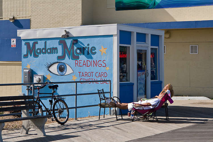 Madam Marie lays in the sun outside her famous Psychic Shop on the boardwalk in Asbury Park, New Jersey
