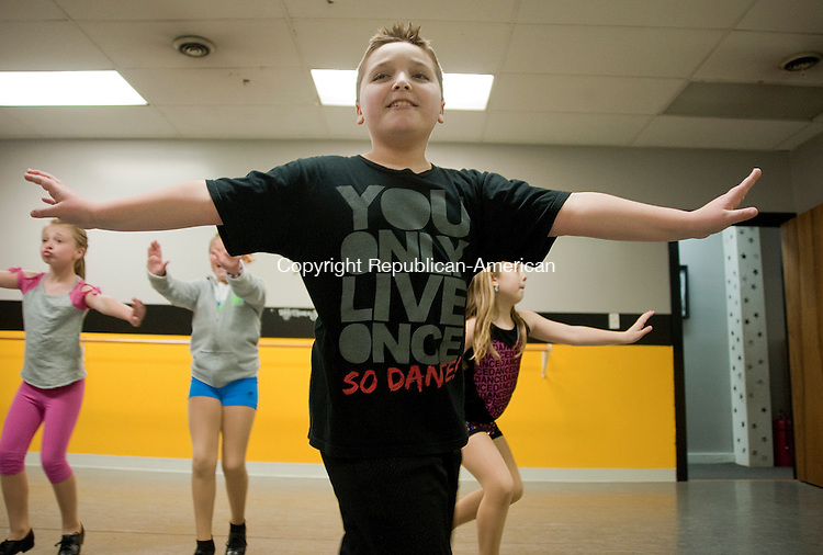 """PLYMOUTH, CT 29 APRIL 2013--042913JS08-Charles Pelletier, 10. of Plymouth, dance with other students in his tap class at Reach for the Stars Dance Studio in Plymouth on Monday. Pelletier recently appeared on the Lifetime TV reality show """"Dance Moms"""". .Jim Shannon Republican-American."""