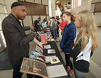 NWA Democrat-Gazette/ANDY SHUPE<br /> Curator Khalid el-Hakim (from left) of Detroit explains the history behind artifacts on display Friday, Feb. 9, 2018, for Meg Gebhart, 12, and Kennedy Phelan, 13, both seventh-graders at Ramay Junior High School in Fayetteville, as they learn about items on display while visiting the Black History 101 Mobile Museum inside the Janelle Y. Hembree Alumni House on the University of Arkansas campus in Fayetteville. A selection of 200 items from a collection of more than 7,000 artifacts from black history in the U.S. was hosted by the Sam M. Walton College of Business Office of Diversity and Inclusion and The Visionairi Foundation.