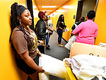 Britney Christian (left) leans against the wall as members of the Lloyd family from Chicago try the key for their daughter's dorm room in the Gillespie Residence Hall on the campus of Harris-Stowe State University in St. Louis on Wednesday August 15, 2018.    Photo by Tim Vizer