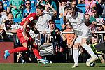 Gareth Bale of Real Madrid and Aaron Escandell of Granada CF during La Liga match between Real Madrid and Granada CF at Santiago Bernabeu Stadium in Madrid, Spain. October 05, 2019. (ALTERPHOTOS/A. Perez Meca)