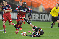 Washington, D.C.- March 29, 2014. Davy Arnaud (8) of D.C. United gets fouled by Jhon Kennedy Hurtado of the Chicago Fire. The Chicago Fire tied D.C. United 2-2 during a Major League Soccer Match for the 2014 season at RFK Stadium.