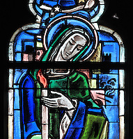 Detail of St Genevieve, stained glass window, in the Collegiale Notre-Dame de Poissy, a catholic parish church founded c. 1016 by Robert the Pious and rebuilt 1130-60 in late Romanesque and early Gothic styles, in Poissy, Yvelines, France. The Collegiate Church of Our Lady of Poissy was listed as a Historic Monument in 1840. Picture by Manuel Cohen