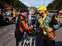 Jun 17, 2018; Bristol, TN, USA; NHRA top fuel driver Mike Salinas (left) congratulates race winner Tony Schumacher following the Thunder Valley Nationals at Bristol Dragway. Mandatory Credit: Mark J. Rebilas-USA TODAY Sports