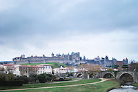 Carcassonne. Languedoc. View over the old city. The old bridge across the Aude river. A rainy and misty winter day. France. Europe.
