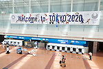 Travellers walk past a Tokyo Olympic and Paralympic Games advertisement on display at Haneda-Airport Domestic Terminal 2 on August 30, 2016, Tokyo, Japan. Between August 24 and October 10 the airport is displaying many Welcome to Tokyo 2020 signs to promote the 2020 Summer Olympic Games. (Photo by Rodrigo Reyes Marin/AFLO)
