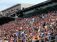 May 26, 2017; Indianapolis, IN, USA; Fans in the crowd stand during the national anthem prior to the Indy Lights Series Freedom 100 at Indianapolis Motor Speedway. Mandatory Credit: Mark J. Rebilas-USA TODAY Sports