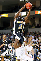 February 26, 2011: Southern Miss guard R.L. Horton (15) goes up for a layup during first half mens Conference USA NCAA basketball game action between the Southern Miss Golden Eagles and the Central Florida Knights at the UCF Arena in Orlando, Fl..