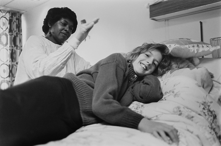 Krystle Proctor (age 11), who has Cystic Fibrosis, gets treatment from Shari Nelson, Rehabilitation Assistant, Department of Physical Therapy at Children's Hospital on Feb. 21, 1994. (Photo by Laura Patterson/CQ Roll Call via Getty Images)