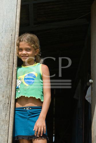Pará State, Brazil. Altamira. Girl in a Brazil flag t-shirt.