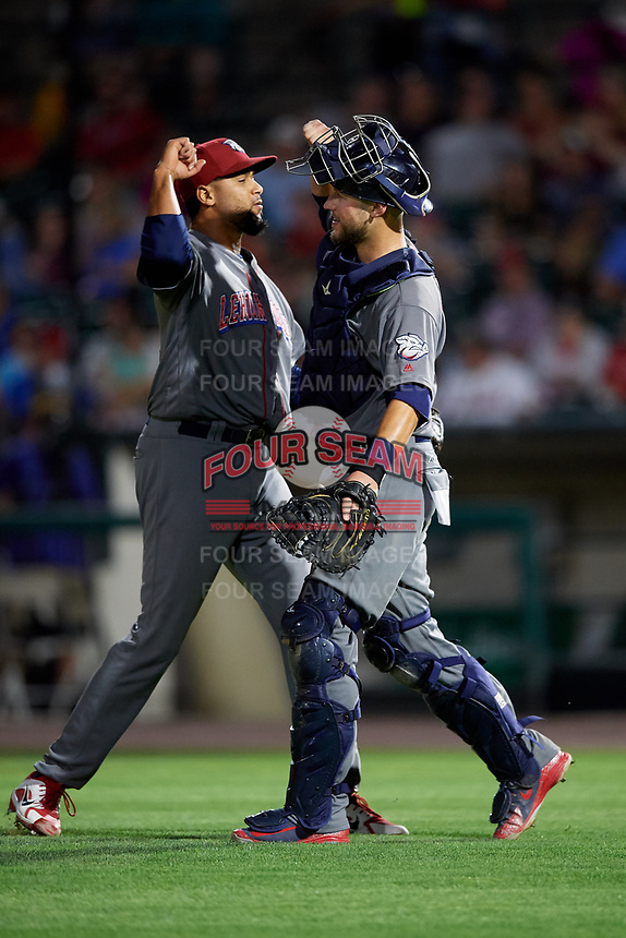 Lehigh Valley IronPigs catcher Logan Moore (35) celebrates with relief pitcher Pedro Beato (44) after the final out of a game against the Rochester Red Wings on September 1, 2018 at Frontier Field in Rochester, New York.  Lehigh Valley defeated Rochester 2-1.  (Mike Janes/Four Seam Images)