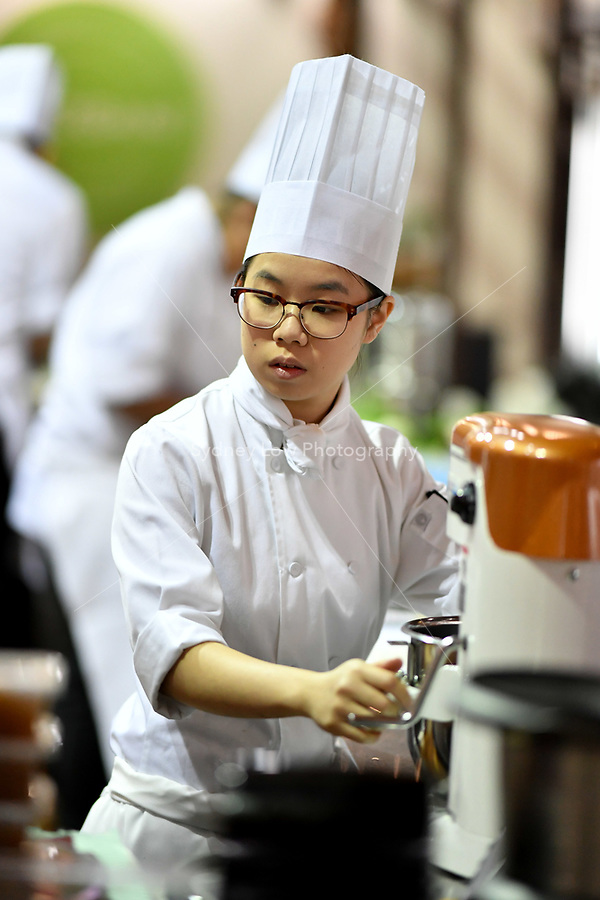 Melbourne, 30 May 2017 - Kimberly Tang commis chef assisting Daniel Soto of the Montague Hotel in South Melbourne in action at the Australian selection trials of the Bocuse d'Or culinary competition held during the Food Service Australia show at the Royal Exhibition Building in Melbourne, Australia. Photo Sydney Low