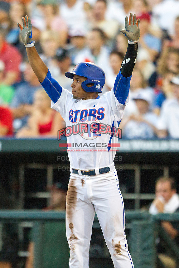 Florida Gators shortstop Richie Martin (12) against the Miami Hurricanes in the NCAA College World Series on June 13, 2015 at TD Ameritrade Park in Omaha, Nebraska. Florida defeated Miami 15-3. (Andrew Woolley/Four Seam Images)