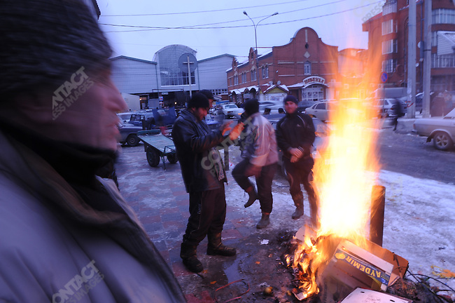 Outside the central market men burned cartons to keep warm in the unusually cold weather that hit the republic, Mahachkala, the Dagestan capitol, January 28, 2010.